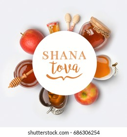 Jewish holiday Rosh Hashana banner design with honey and apples. View from above. Flat lay