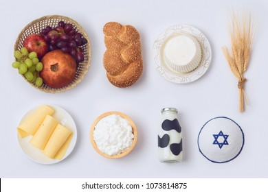 Jewish holiday Shavuot concept with milk and dairy products on white background. View from above. Flat lay