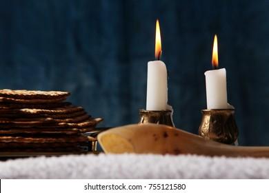Jewish Holiday symbol, jewish food passover jewish passover food Pesach candlesticks with lit candles