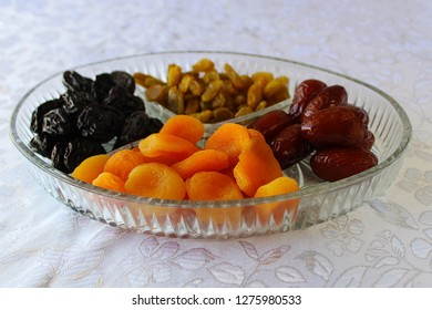 Jewish holiday Tu Bishvat in Israel: Traditional jewish food, Dried fruits. Apricots,  Prunes, Dates and Raisins in a glass tray