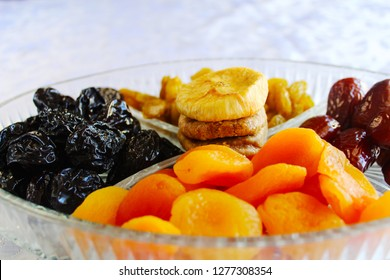 Jewish holiday Tu Bishvat, Israel. Traditional dried fruits in a glass tray: Apricots, Dates, Raisins, Prunes, Figs