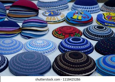 Jewish kippas (yarmulkes). Jewish religious caps kippahs (yarmulke) in a souvenir shop in Jerusalem, Israel. Traditional embroidered jewish male headwear kippas on a souvenir market in Jerusalem.