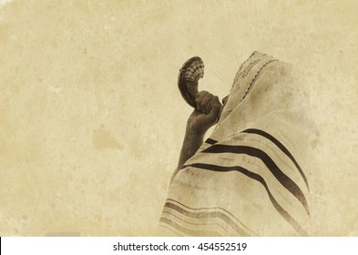 Jewish man blowing the Shofar (horn) of Rosh Hashanah (New Year). Religious symbol. Old style filter and overlay