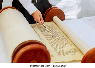 Jewish man dressed in ritual clothing 5 SEPTEMBER 2016 USA NY Hand of boy reading the Jewish Torah at Bar Mitzvah Bar Mitzvah Torah reading