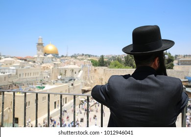 Jewish man overlooks the Western wall (Wailing wall) in Jerusalem where Jews come to pray at the last remaining relic from the Old Temple of Jerusalem