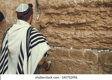 Jewish man praying at the sacred Wailing Wall, Western Wall, Jerusalem, Israel