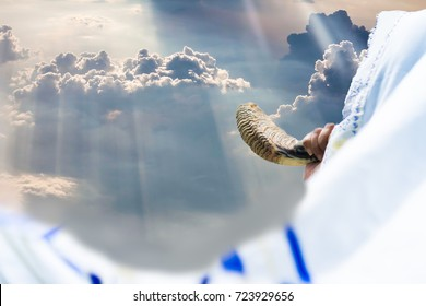 Jewish man in Tallit blowing the Shofar (horn) of Rosh Hashanah (New Year Jew).Religious and Holidays symbol concept.