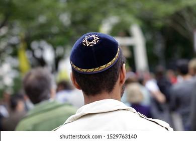 A Jewish man wears a blue Kippah with a Star of David on it in Sao Paulo, Brazil.