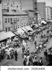 Jewish market on the East Side, New York City. The neighborhood was densely packed district of tenements, housing and employing poor immigrants from Eastern Europe.