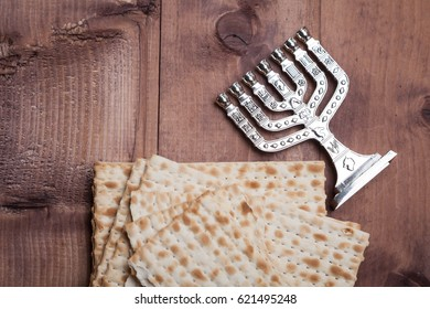 Jewish matza with menorah on table