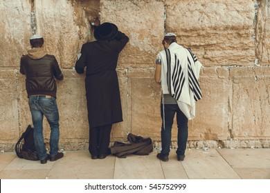 Jewish men praying at the sacred Wailing Wall, Western Wall, Jerusalem, Israel