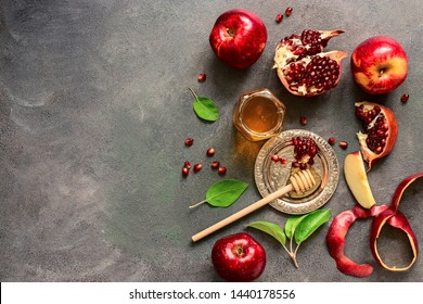 Jewish New Year - Rosh Hashanah. Apples, pomegranate and honey on a dark rustic background. Traditional Jewish food. Top view, flat lay,space for your text