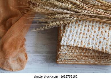 Jewish passover matzah isolated on wood background