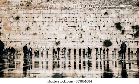 Jewish people praying at the western wall in the old town of Jerusalem, Israel.