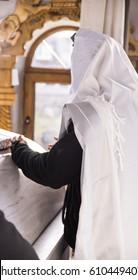 jewish prayer with tallit and tefillin