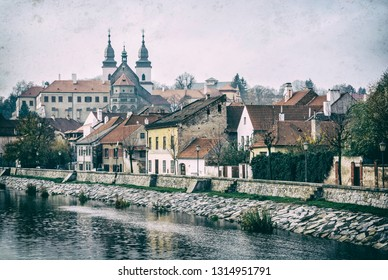 Jewish quarter, chateau and Jihlava river, Trebic, Czech republic. Travel destination. Architectural theme. Analog photo filter with scratches.