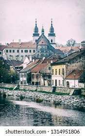 Jewish quarter, chateau and Jihlava river, Trebic, Czech republic. Travel destination. Architectural theme. Vertical composition. Analog photo filter with scratches.