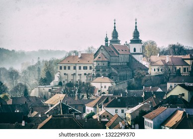 Jewish quarter and chateau in Trebic, Czech republic. Travel destination. Architectural theme. Analog photo filter with scratches.