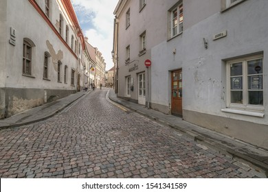 Jewish Quarter, Vilnius, Lithuania - September 29, 2019: Gaono street, at the  Small Ghetto entrance during WWII, and the Gaon of Vilnius image on the wall, commemorated by Vilnius municipality.