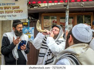 Jewish rabbi hasid blows Shofar. Uman, Ukraine - 21 September 2017: Rosh Hashanah, Jewish New Year.