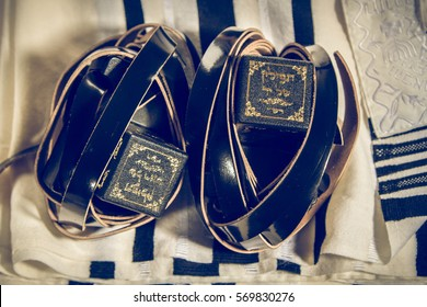 Jewish ritual objects, prayer vestments, Tefillin with a hebrew inscription: The arm tefillin and The head tefillin. Toned image