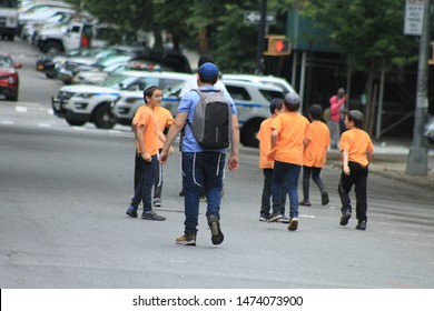 Jewish School Boys, I group of Jewish school boys wearing orange shirt seen in the crown heights section of Brooklyn on a sunny summer day August 7 2019