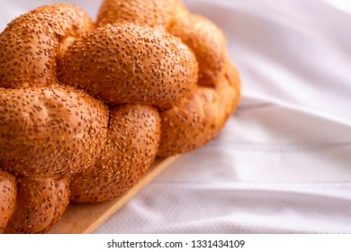 Jewish shabbat bread on white fabric.
