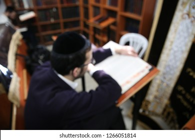 """A Jewish student studying Torah books in """"yeshiva"""" (Hebrew for """"school"""") as is done in Jewish tradition"""