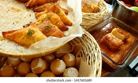 Jewish traditional cuisine. Jewish pastries in straw baskets on market shelf