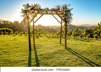 Jewish traditions wedding ceremony. Wedding canopy chuppah or huppah with the sun behind it