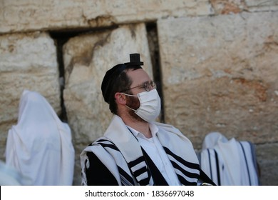 Jewish worshipers pray at the separation partitions in front of the Western Wall in the Old City of Jerusalem,Israel on October 19, 2020, after a one-month lockdown in response to coronavirus.