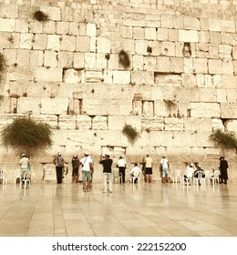 Jewish worshipers pray at the Wailing Wall. Vintage retro style