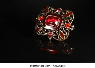 Jewlery red and gold. Black background
