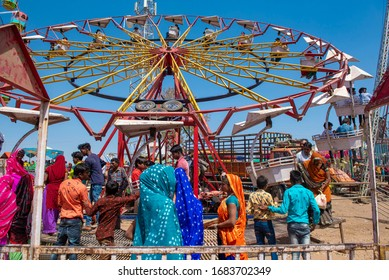 Jhabua  / India 7 March2020 A View of one of the most famous bhagoria colorful festivals people enjoying Cliffhanger (ride) at Ranapur in jhabua districts of Madhya Pradesh India