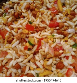 jhalmuri a street snack of India made of puffed rice gram tomato chilli and onion slices and mixture