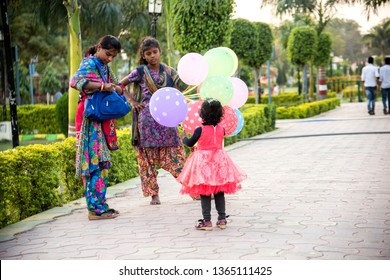 JHANSI, INDIA 28 FEBRUARY 2018 : Unidentified woman vendor selling balloons in at city park of Jhansi, India