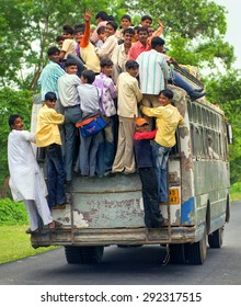JHANSI, INDIA - AUGUST 19: Workers returning home at the evening in an overloaded bus in Jhansi province. Jhansi, India on August 19, 2013