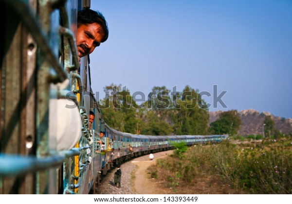 JHANSI, INDIA - MARCH 3: Unidentified man on the train on March 3, 2011 in Jhansi. Indian railway network comprises of 115,000km of track and 7,500 stations.