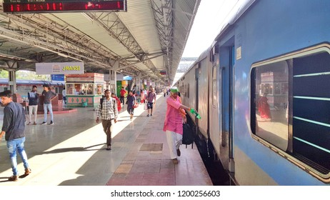 Jhansi, India - Septembar 30, 2018:  Express passenger train stopped at Jhansi railway station in the evening time and the passengers are waiting for their particular trains.