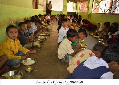 Jhargram, West Bengal, India- January 30, 2019: Mid day meal program, an Indian government initiative, is being running in a primary school. Pupils are taking their meal.
