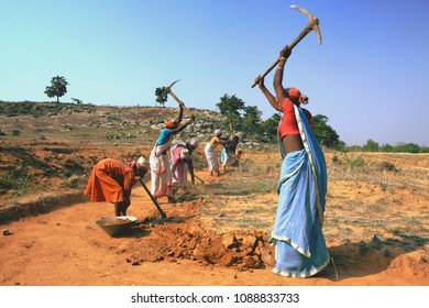 Jharkhand,India,May,17,2011: Tribal village women workers manually excavate barren land under sponsored rural welfare employment programme in remote Jharkhand,India,Asia