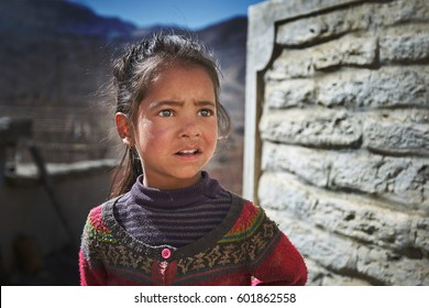 JHARKOT/NEPAL - NOVEMBER 20, 2016: Portrait of a young girl in a rural tibetan village in Himalayas, Nepal