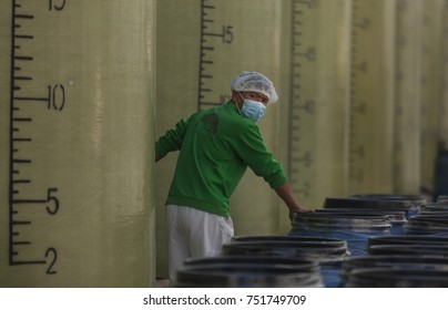 JIANGMEN, CHINA - NOV. 4. 2017: Workers in food factory for producing sauces.