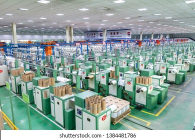 Jiangxi, China - April 19, 2019: Workers shuttle in the glass fiber workshop of Jiujiang Co., Ltd. of Jushi Group. In April, China's Manufacturing Purchasing Managers Index (PMI) was 50.1%.