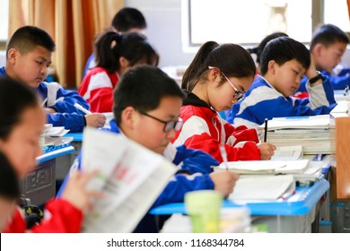 JIANGXI CHINA-April 19, 2018: April 19, 2018: junior high school students in Jiangxi, China, wear spectacles for nearsightedness in class. The prevalence of myopia in China ranks first in the world.