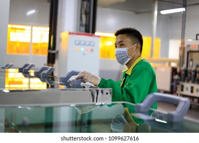 JIANGXI CHINA-April 19, 2018: workers are producing PCB in an electronic enterprise workshop in eastern China.Products are sold to world famous factories such as APPLE, SAMSUNG, HUAWEI, BYD, Foxconn.