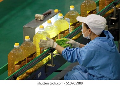 JIANGXI CHINA-April 20, 2013: the workers at the production line of COFCO Jiujiang Co. Ltd., a bucket of COFCO's brand of edible oil is Everfount line.