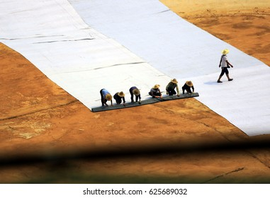 Jiangxi, China-July 21, 2014 : workers work on construction sites during hot summer weather. These workers are rural farmers, known as migrant workers, without any labor protection.