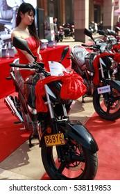 JIANGXI CHINA-Mar26, 2012: Jiujiang people in a store to buy Sino Japanese joint venture SUZUKI motorcycle. 2015, China's motorcycle production enterprises cumulative export amount of over $5 billion.