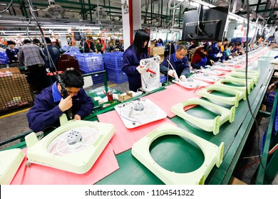 JIANGXI CHINA-March 17, 2018: rural migrant workers assembled electric fans in enterprises, exported to the EU,Jiujiang in eastern China. The rise in labor costs in China has been widely concerned.